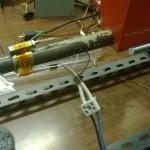 Sensore per la temperatura avvitato dentro un dado lungo M6, e montata sopra la resistenza con l'ormai famoso nastro kapton